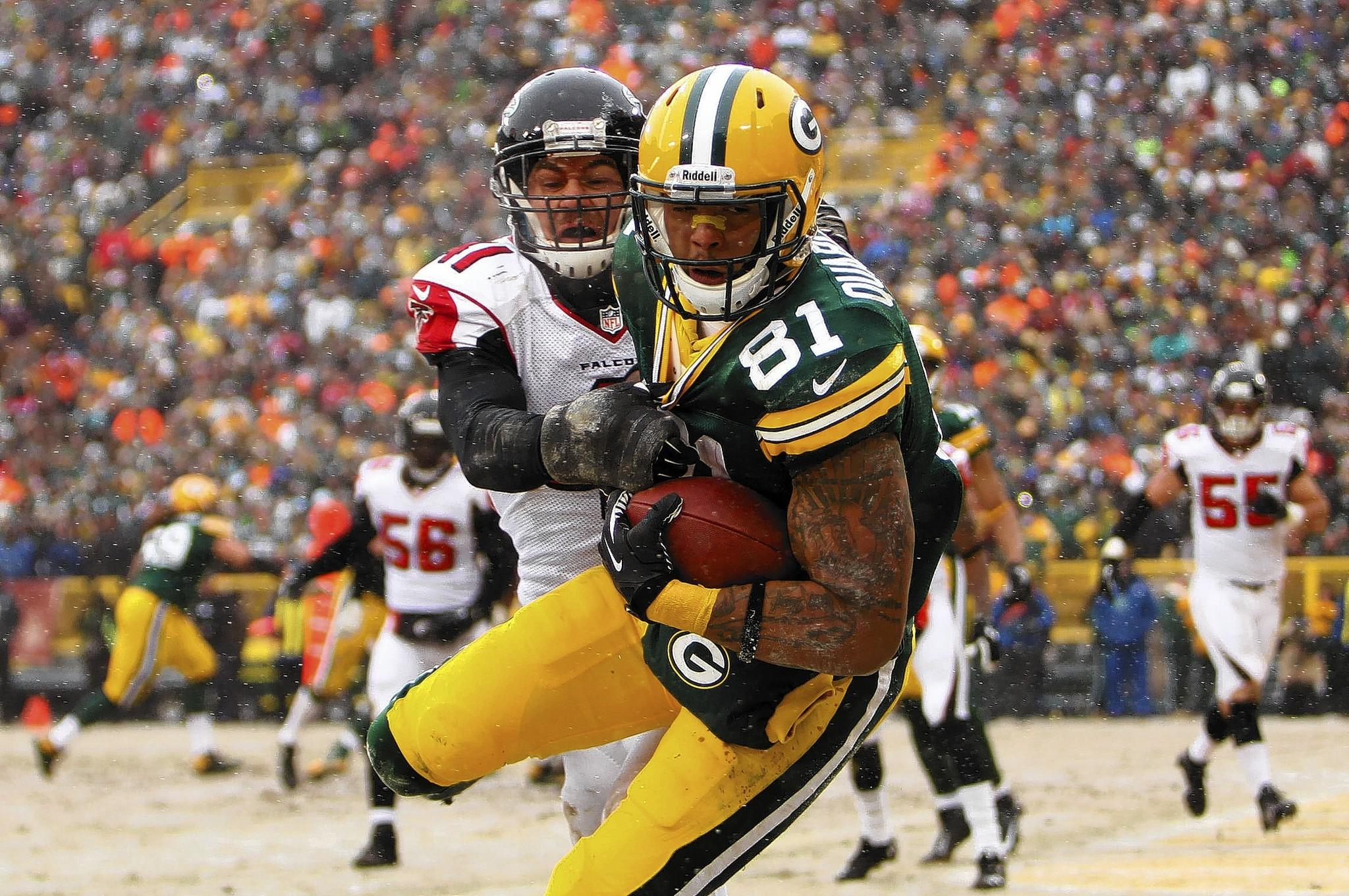Andrew Quarless #81 of the Green Bay Packers makes the catch in the endzone for a touchdown during the second half of play against the Atlanta Falcons at Lambeau Field on December 08, 2013 in Green Bay, Wisconsin.