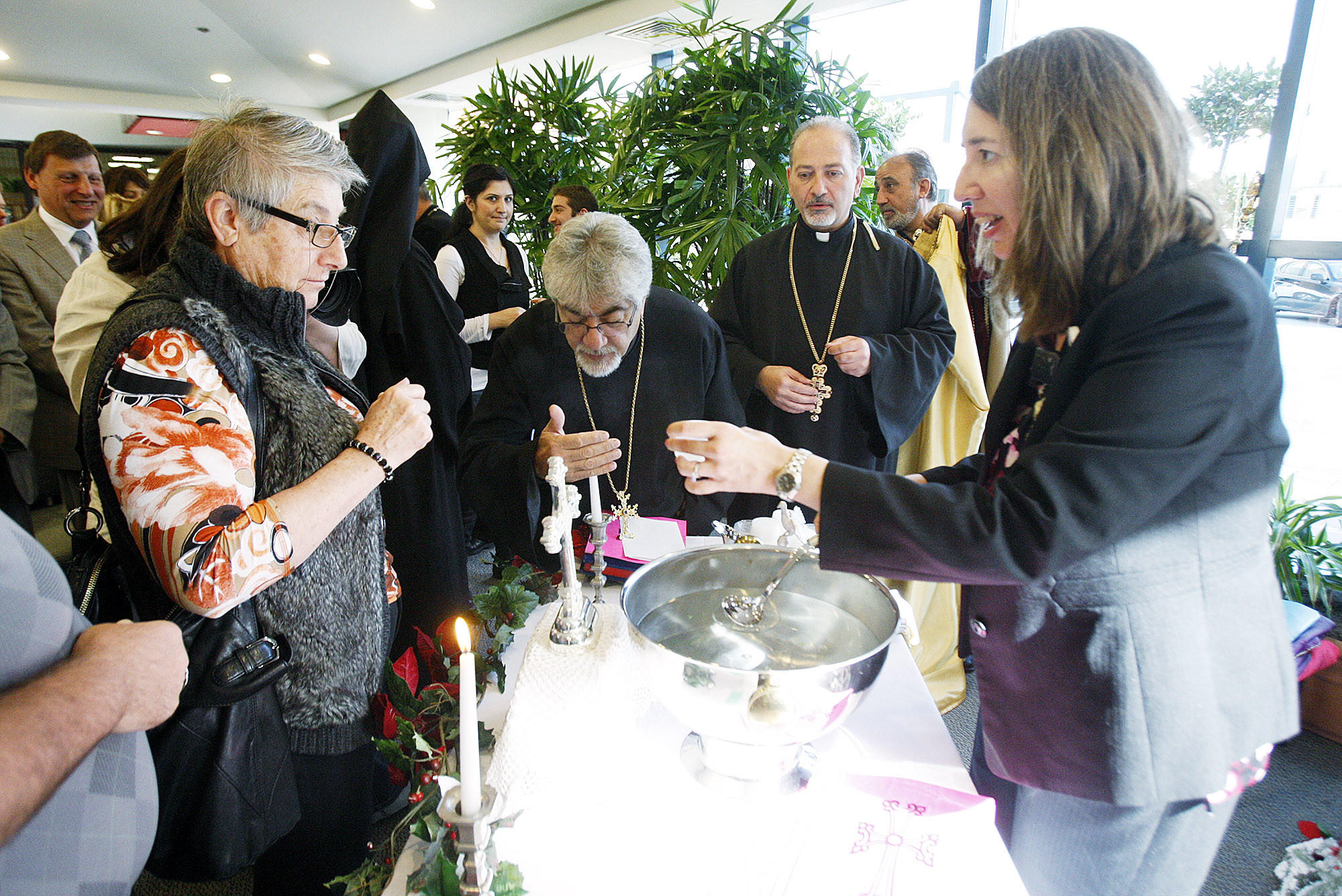 "Blessed water is given to hospital staff for personal use, or to take to patients, after the celebration of the New Year and Armenian Christmas with the ""Blessing of the Water"" ceremony conducted at the entrance of Glendale Memorial Hospital by His Eminence Archbishop Moushegh Mardirosian, Prelate of the Western United States of America on Friday, January 3, 2014."