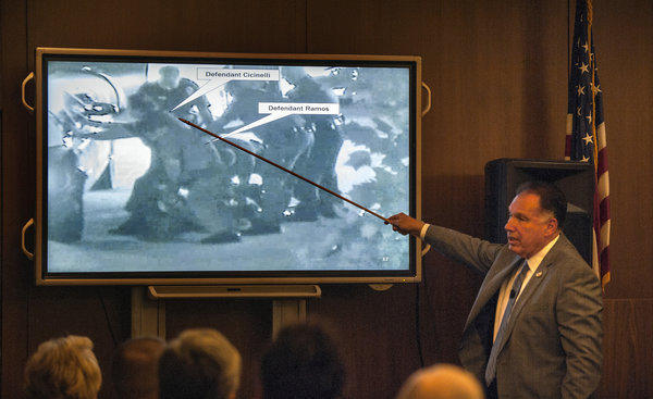 Orange County Dist. Atty. Tony Rackauckas shows the jury an image of police trying to subdue Kelly Thomas on July 5, 2011, during the trial of former Fullerton officers Manuel Ramos and Jay Cicinelli.