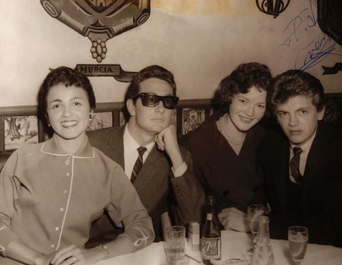 This undated handout photograph shows Maria Elena Holly, left, Buddy Holly, an unidentified woman, and Phil Everly.