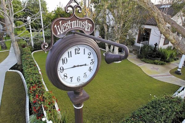 Marianne and David Wegener's vintage clock sits atop a 12-foot iron pole at East 19th Street and Westminster Avenue in Costa Mesa. It has garnered its share of attention for nearly 35 years.