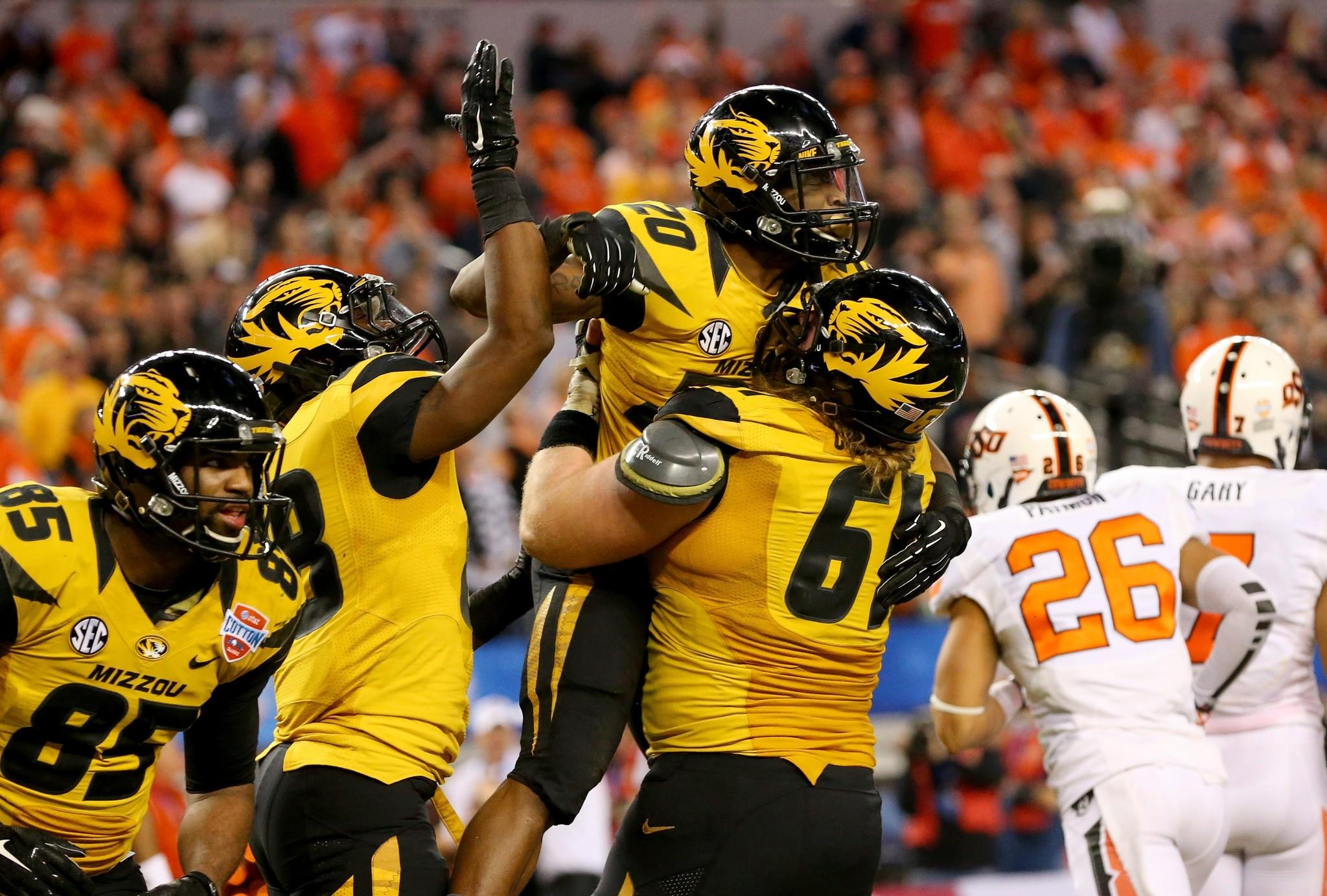 Missouri's Henry Josey celebrates scoring a 25-yard touchdown with Max Copeland in the fourth quarter.