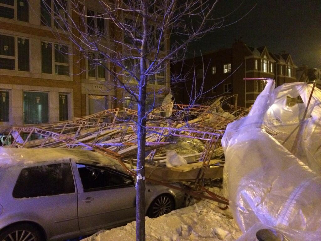 Four vehicles were damaged when scaffolding collapsed next to a North Side apartment building Friday night.