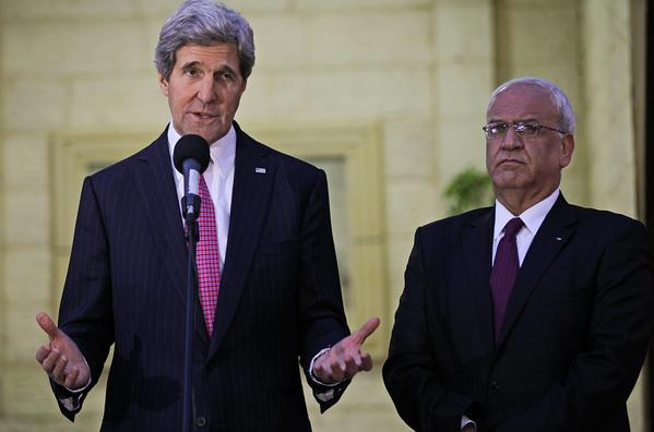 Secretary of State John F. Kerry, left, and top Palestinian negotiator Saeeb Arekat address the media after a meeting Saturday with Palestinian Authority President Mahmoud Abbas in the West Bank town of Ramallah.
