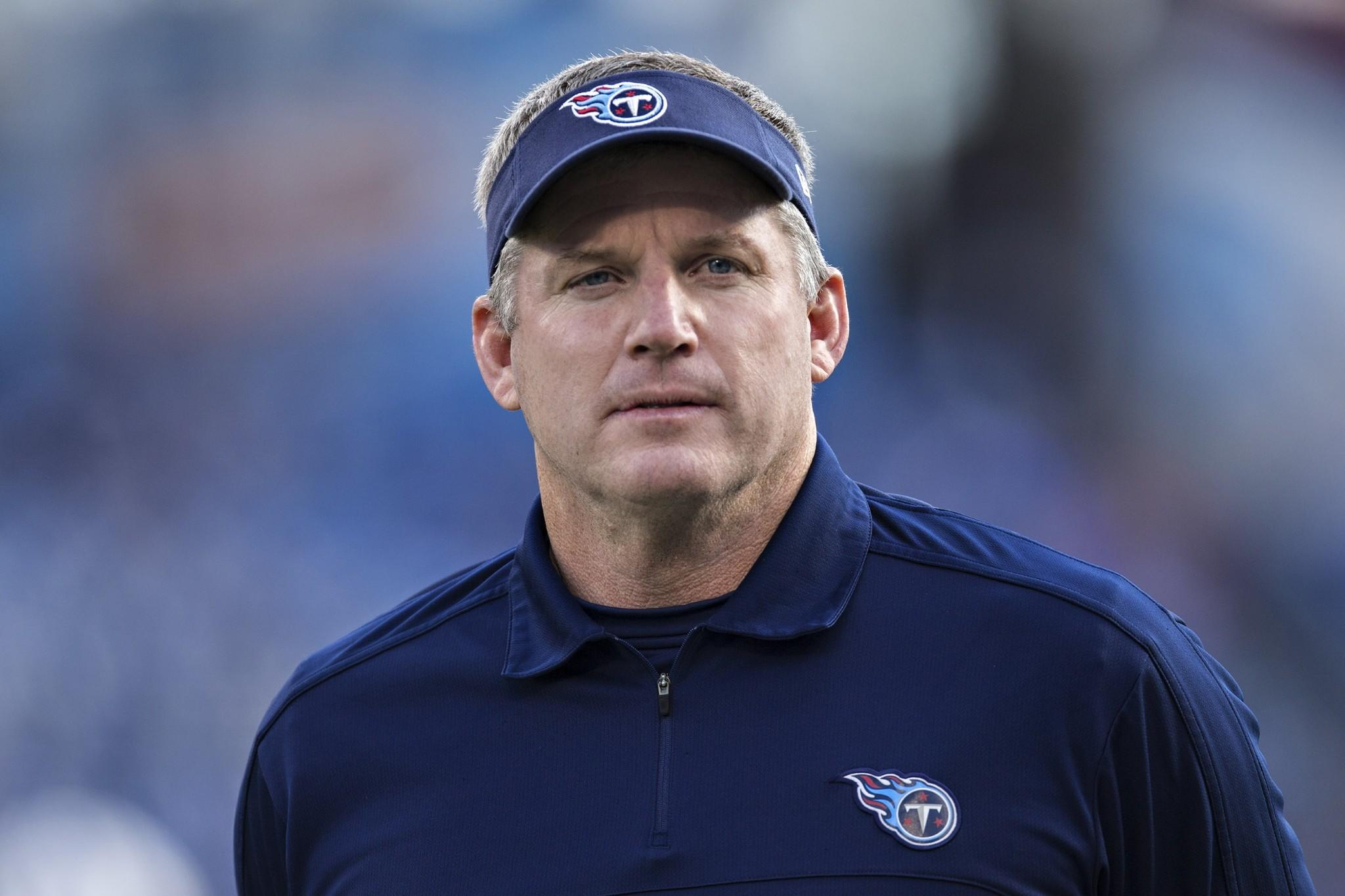 Coach Mike Munchak of the Tennessee Titans walks off the field after a game against the Houston Texans at LP Field on December 29, 2013.