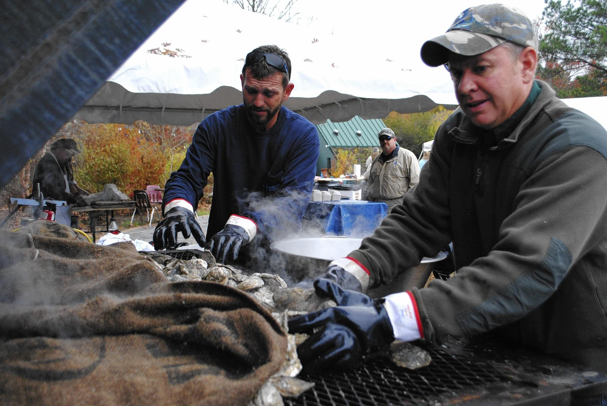 L to R: Chris Green and Herb Graham roasting oysters at the Awww Shucks! Oyster Roast at the Virginia Living Museum, Nov. 16, 2013.