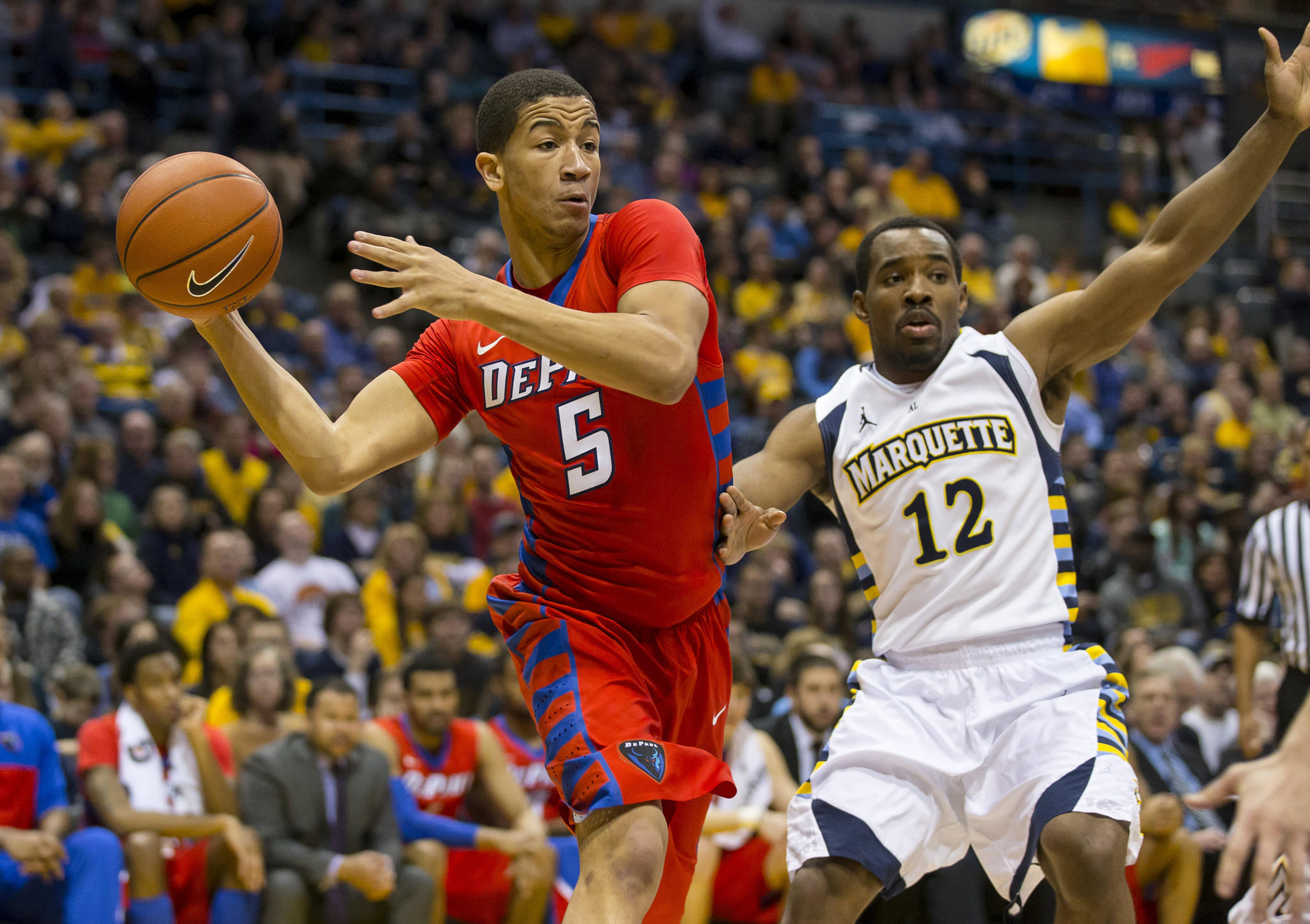 DePaul's Billy Garrett Jr. passes the ball in front of Marquette's Derrick Wilson during the second half at BMO Harris Bradley Center.
