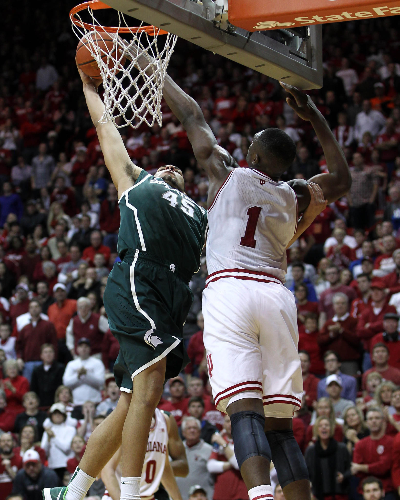 Michigan State's Denzel Valentine drives to the basket with Indiana's Noah Vonleh defending during the second half at Assembly Hall.