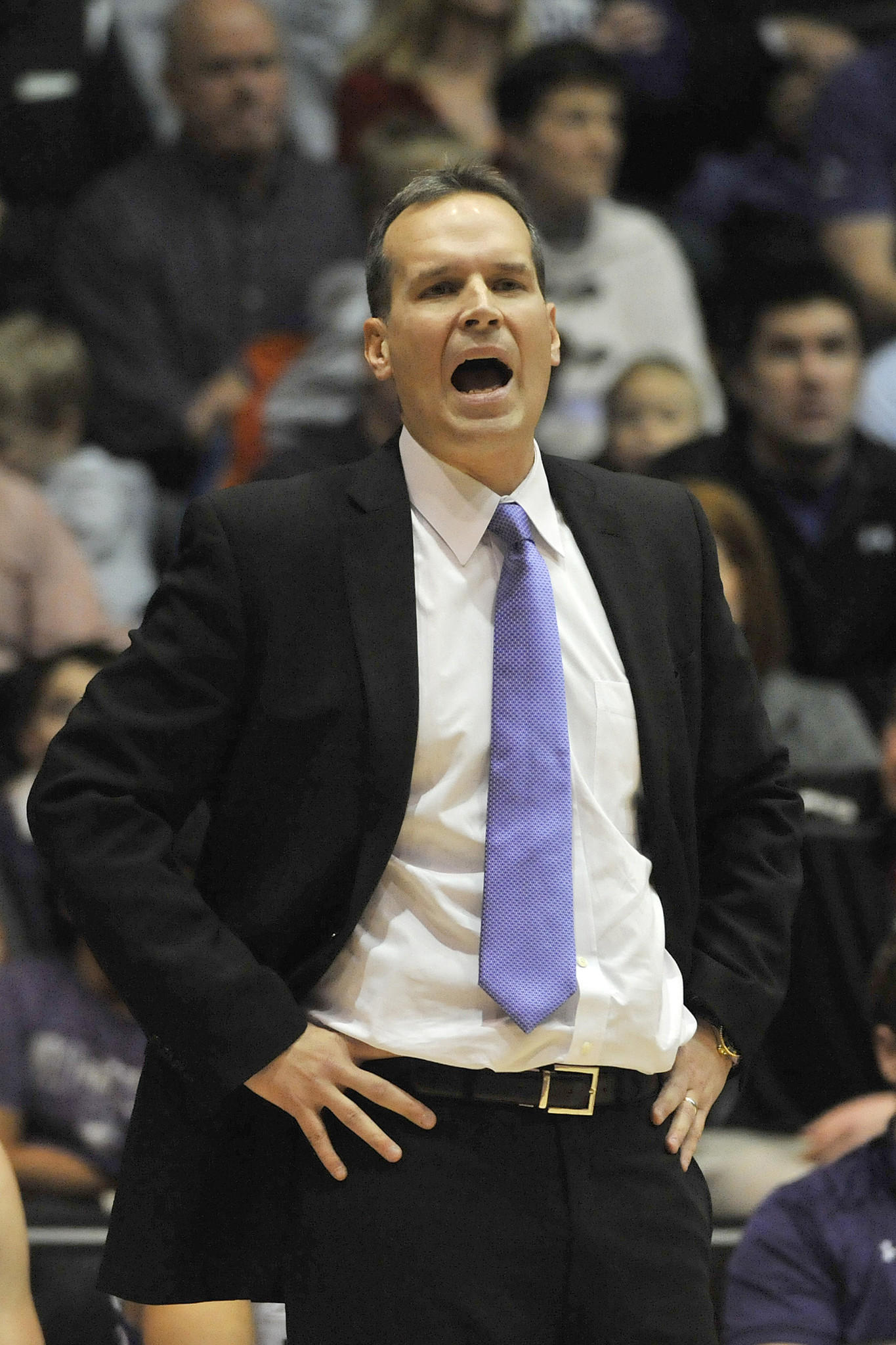 Northwestern coach Chris Collins coaches against Wisconsin during the first half.