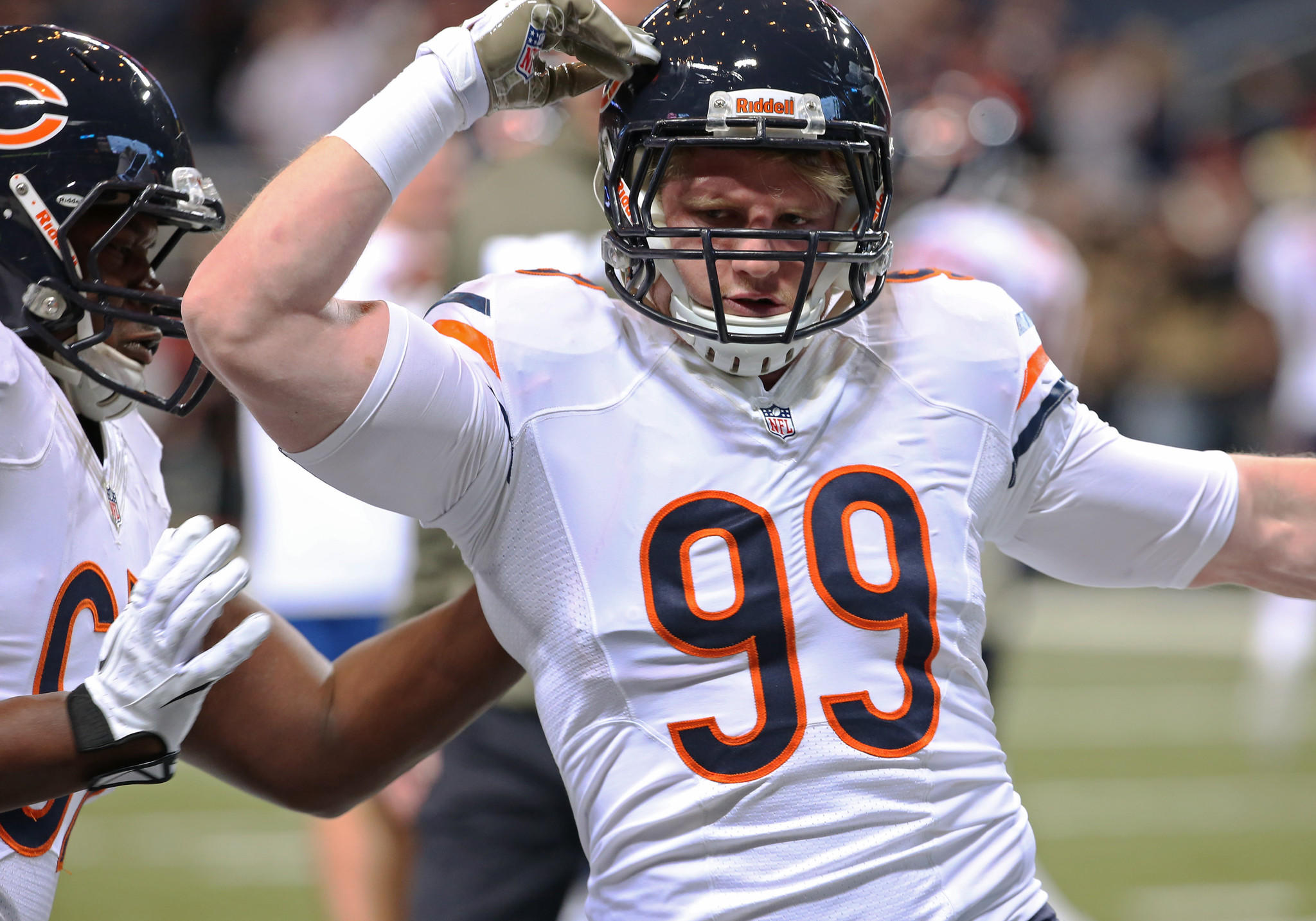 Shea McClellin warms up before a game against the Rams.