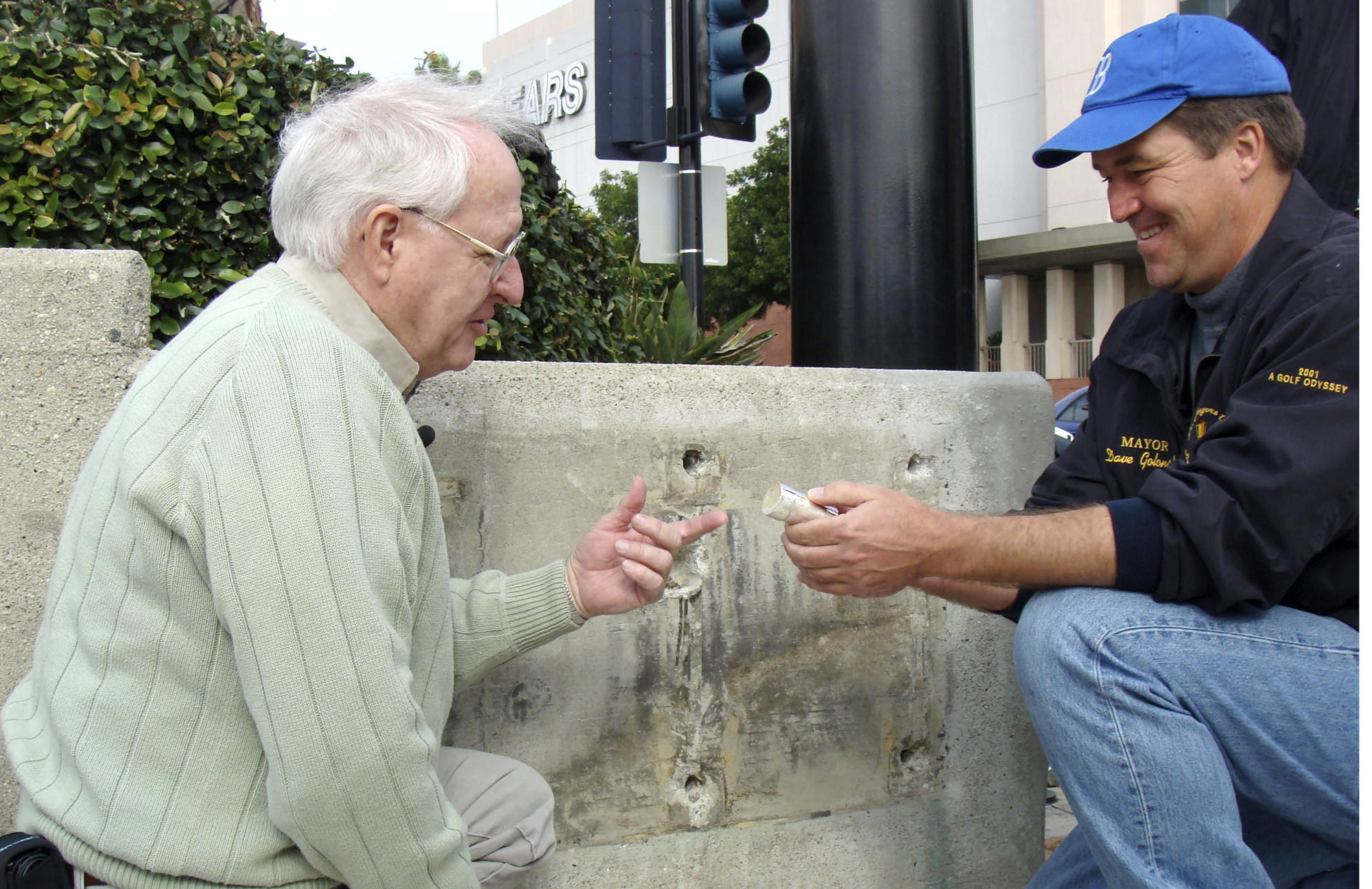 Lifelong Burbank resident Stan Lynch passed away Jan. 3 at the age of 68. He is pictured here with former mayor Dave Golonski holding a time capsule that was placed in the Magnolia St. bridge in 1959. Lynch was present for the capsule's original placement in the bridge.