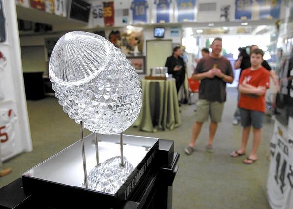 Visitors stop to take a look at the BCS National Championship trophy at the Newport Sports Museum on Friday.
