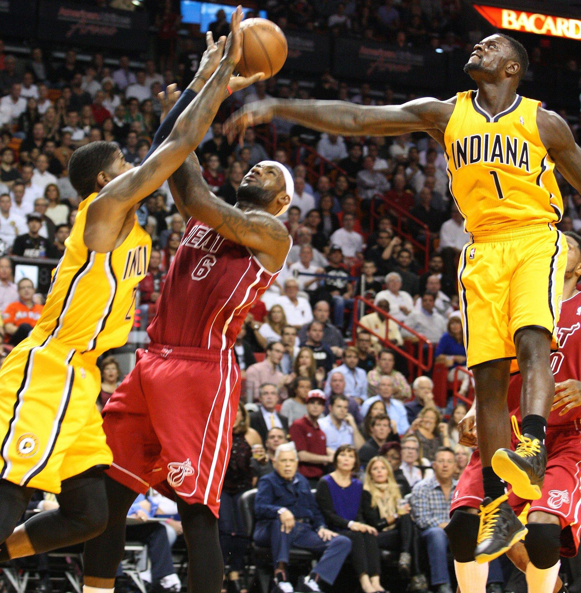 The Pacers' Roy Hibbert and Lance Stephenson guard the Heat's LeBron James during the second quarter.