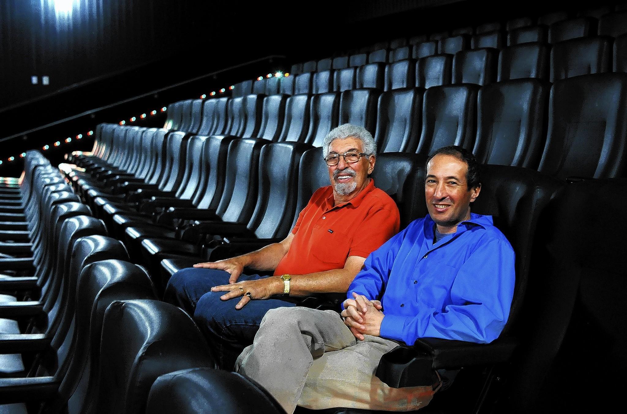 """Robert Laemmle and his son Greg sit at the Laemmle Royal Theatre in West Los Angeles. """"If you look at the track record of family businesses that have made it, to have survived this many generations is quite a remarkable achievement,"""" Greg Laemmle said."""