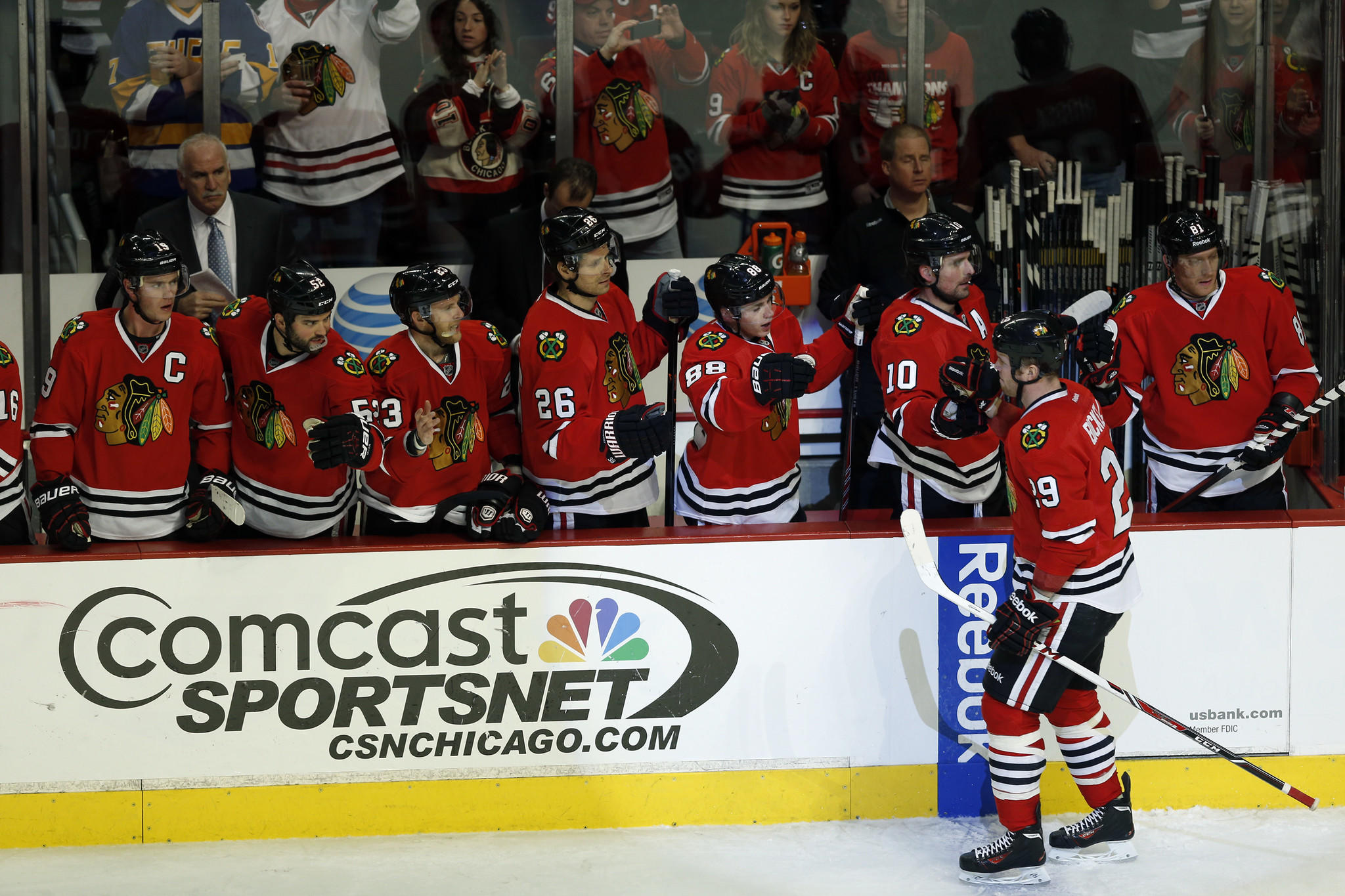 Bryan Bickell celebrates his goal with bench against Devils in the 2nd period.