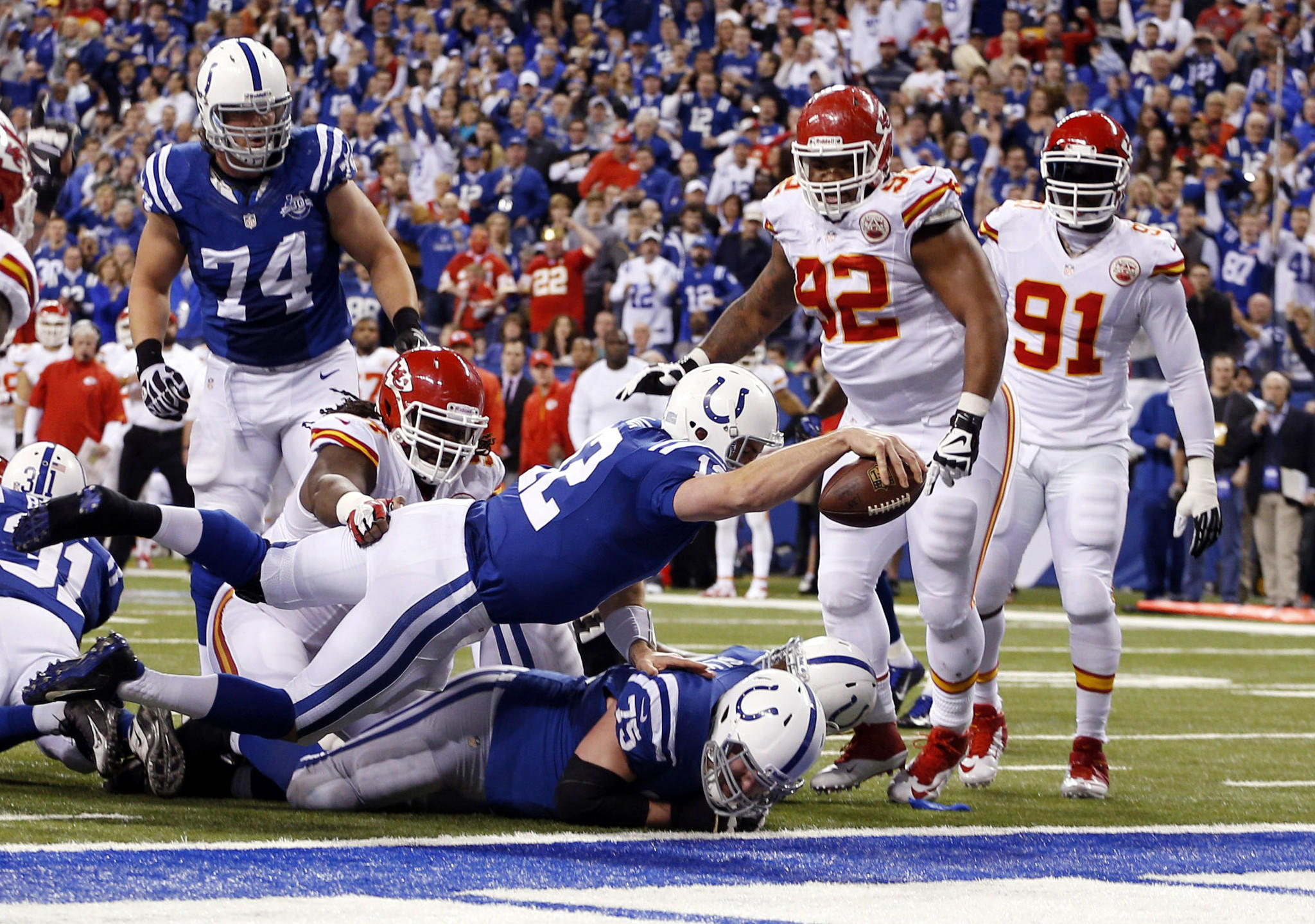 Colts quarterback Andrew Luck dives in for a touchdown against the Chiefs in the fourth quarter.