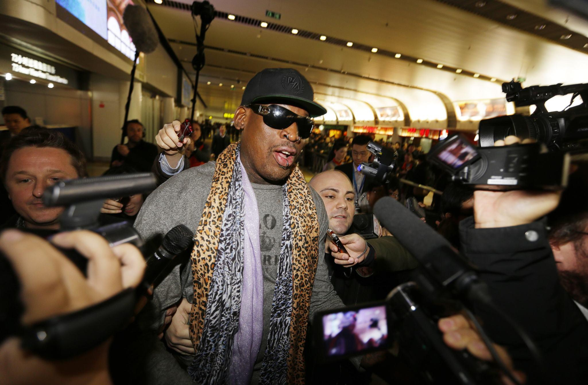 Former NBA basketball player Dennis Rodman speaks to the media after returning from his trip to North Korea at Beijing airport on December 23.