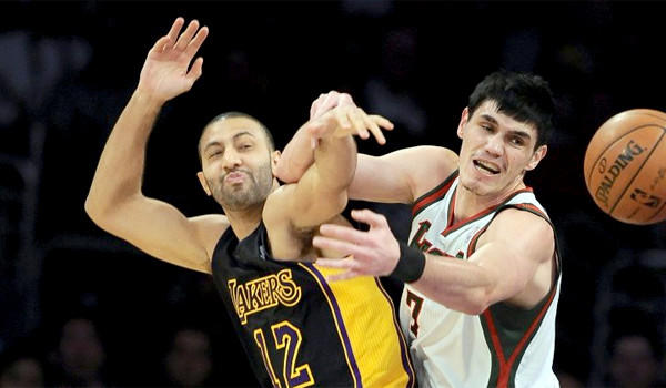 Kendall Marshall and Milwaukee's Ersan Ilyasova fight for a rebound on Dec. 31. Marshall became a starter after the injuries forced the Lakers to sign the former first-round draft pick of the Phoenix Suns.