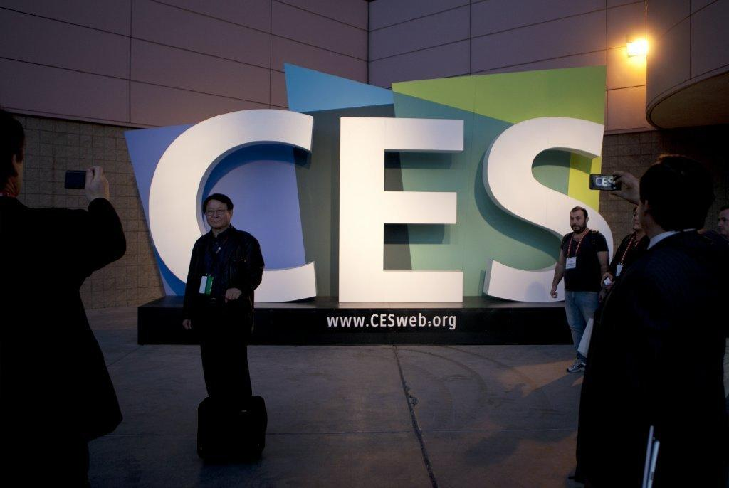 Attendees take photographs outside last year's Consumer Electronics Show in Las Vegas.