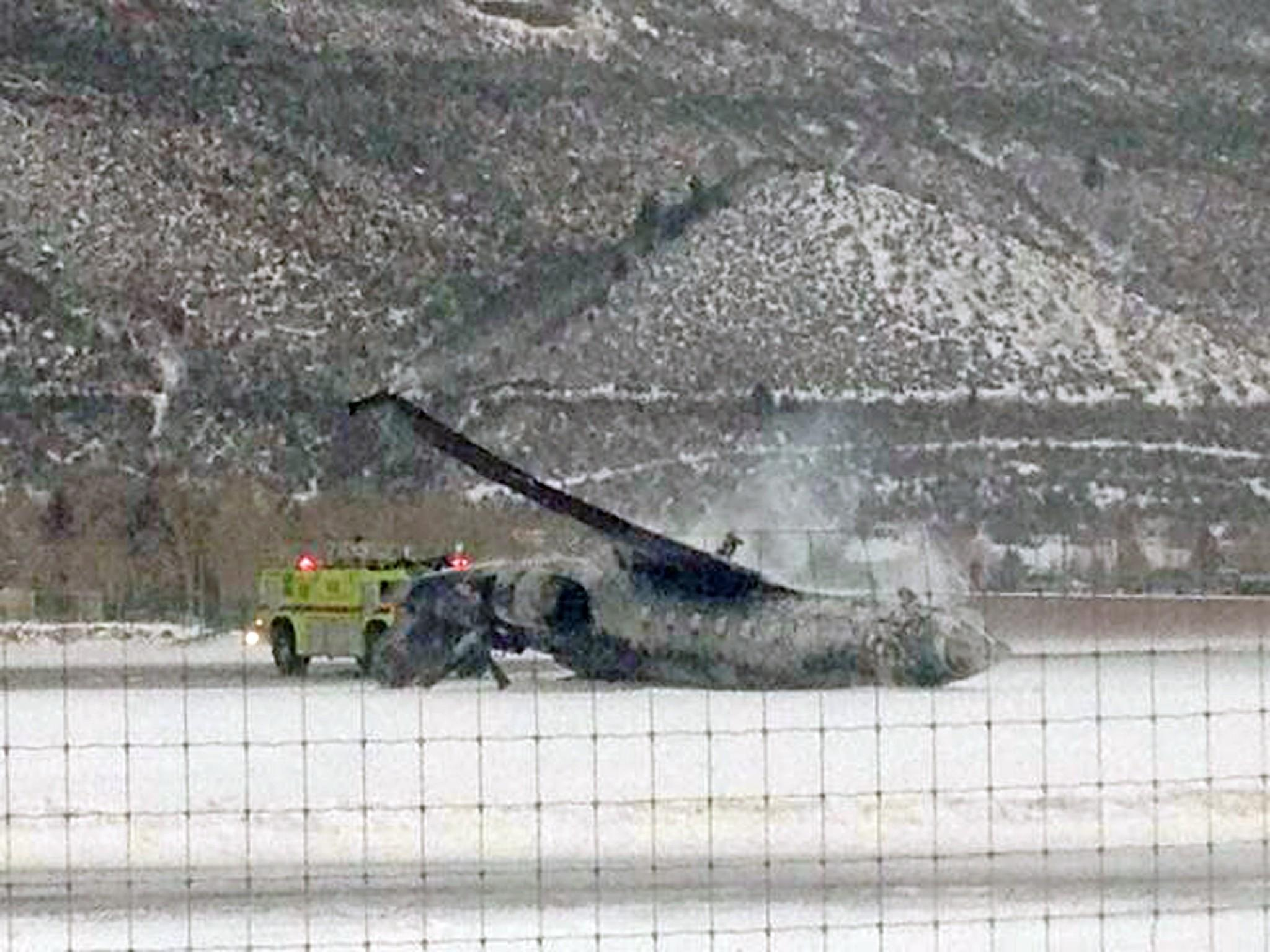The wreckage of a private jet lies on the runway after it crashed and burned as it landed at Aspen/Pitkin County Airport in Colo. on Jan. 5.