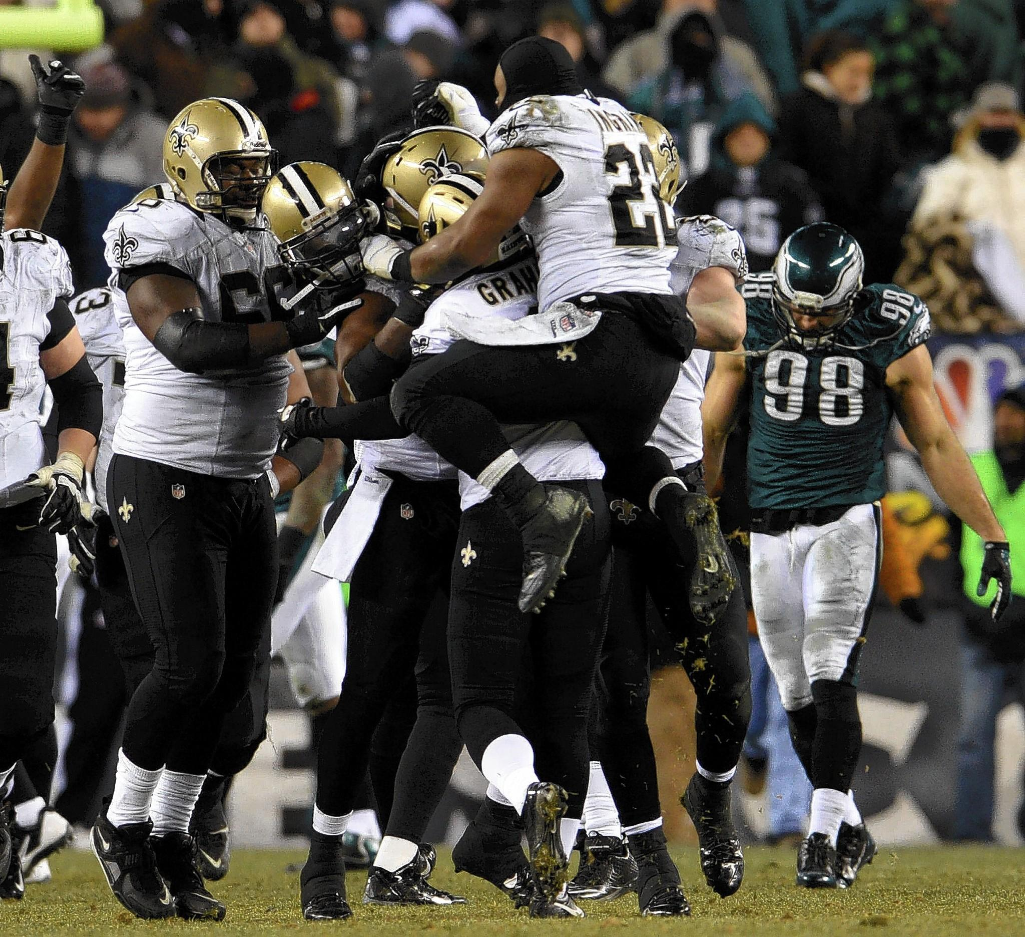 The New Orleans Saints celebrate after kicker Shayne Graham's game-winning field goal against the Philadelphia Eagles at Lincoln Financial Field in Philadelphia on Saturday.