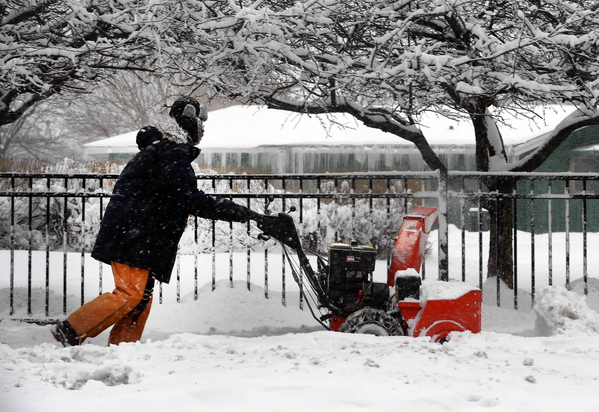 Ralph Richmond,, an engineer at Otis Elementary School, at 525 N. Armour St, Chicago, in Chicago uses a snow blower to get the sidewalks ready for students.