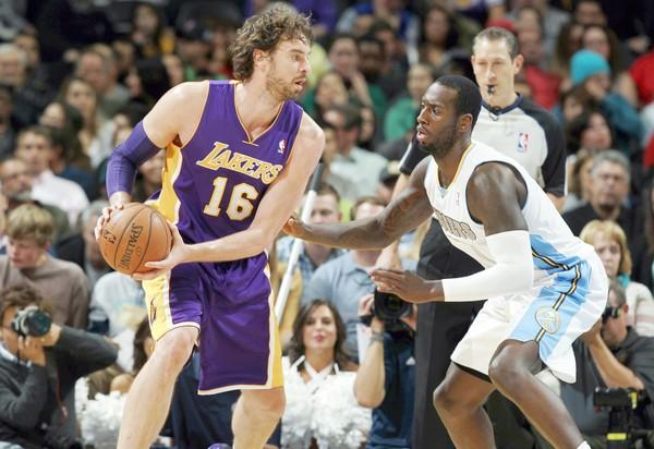 Lakers power forward Pau Gasol works in the post against Nuggets power forward J.J. Hickson in the second half of a game earlier this season.