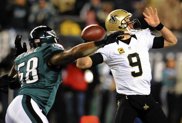 Philadelphia Eagles outside linebacker Trent Cole (58) pressures New Orleans Saints quarterback Drew Brees at Lincoln Financial Field in Philadelphia on Saturday night.