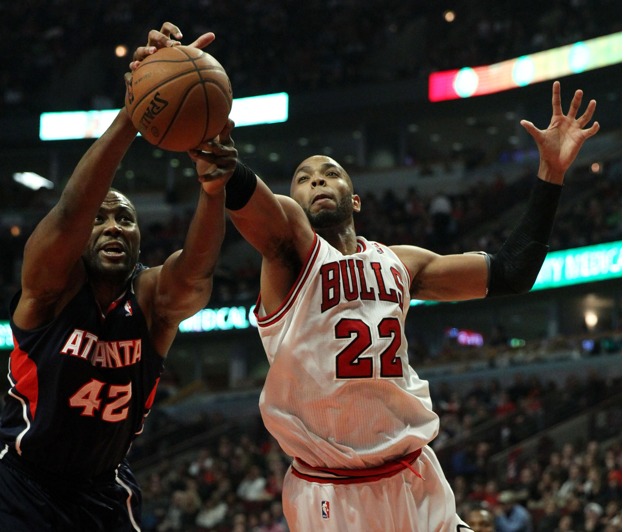 The Hawks' Elton Brand and Taj Gibson battle for a rebound in the first half at the United Center.