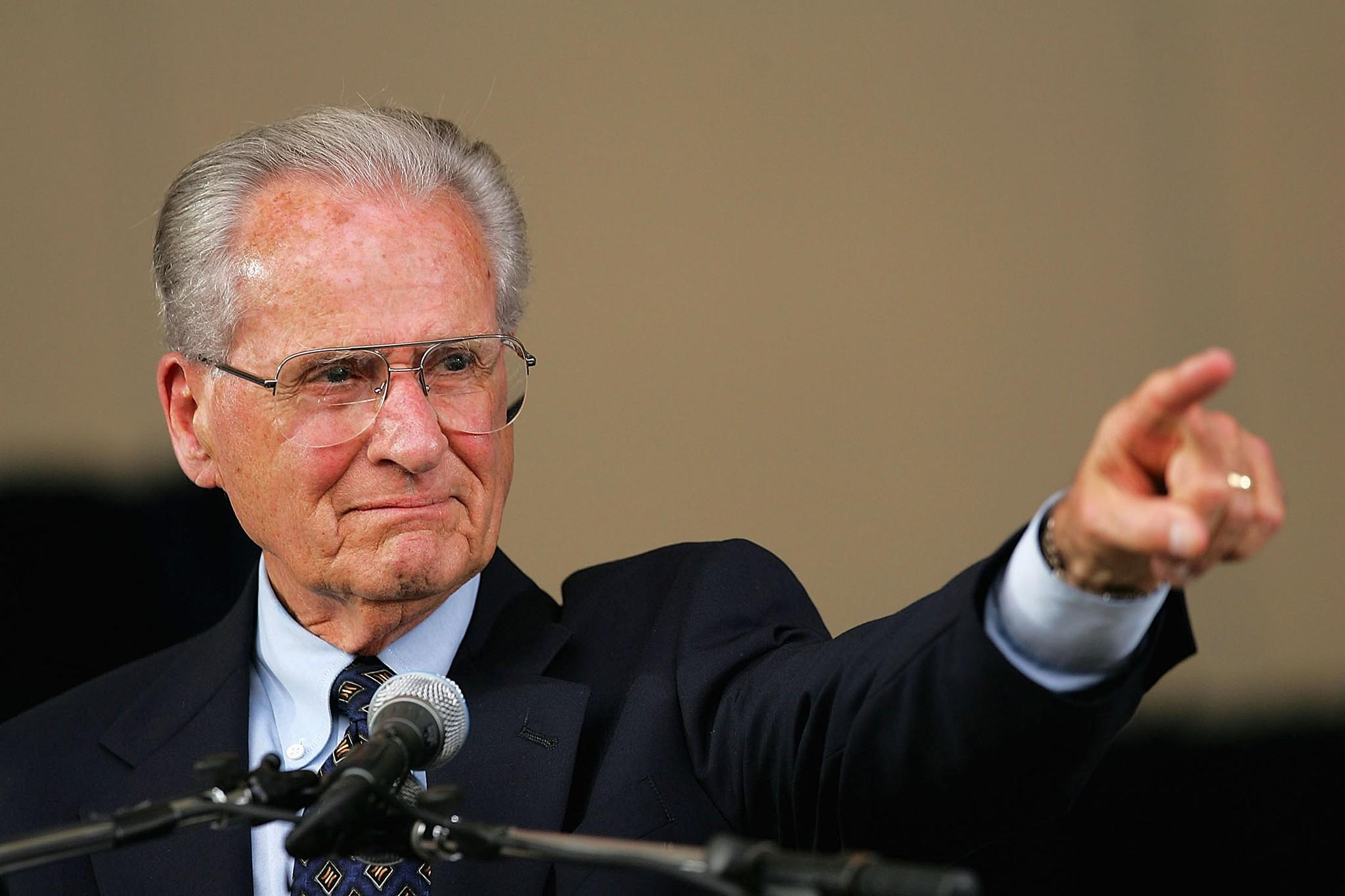 Jerry Coleman points to his wife in the crowd after receiving the Ford C. Frick Award, presented annually to a baseball broadcaster for major contributions to the game, during the Baseball Hall of Fame induction ceremony on July 31, 2005.