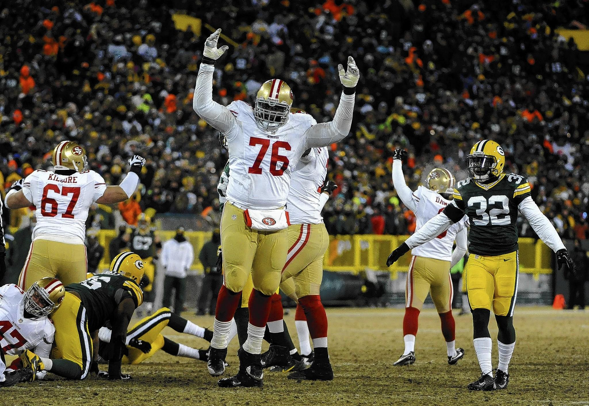 The San Francisco 49erscelebrate after beating the Green Bay Packers 23-20 on a late field goal by kicker Phil Dawson.