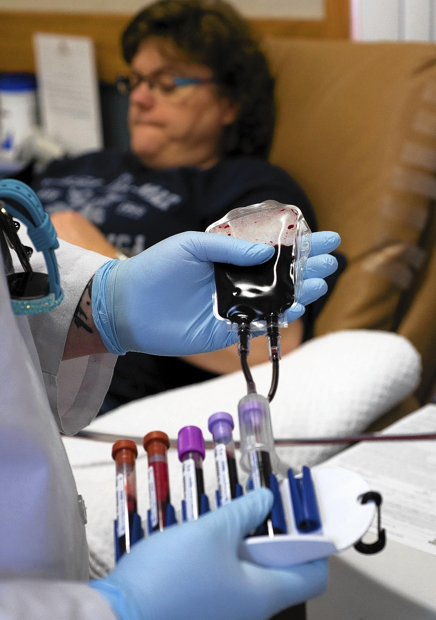 Collection Specialist Nancy Peacock (foreground) handles samples as Karen Furler of Nazareth gets her blood drawn Sunday at the Miller Keystone Blood Center in Hanover Township, Northampton County. Miller Keystone, the primary provider of blood, platelets and plasma to roughly two dozen hospitals in the Greater Lehigh Valley and western New Jersey region, last week put out an urgent call for donations. Blood centers normally experience lower collection levels during the holidays, but that situation is magnified when Christmas and New Year's fall mid-week.