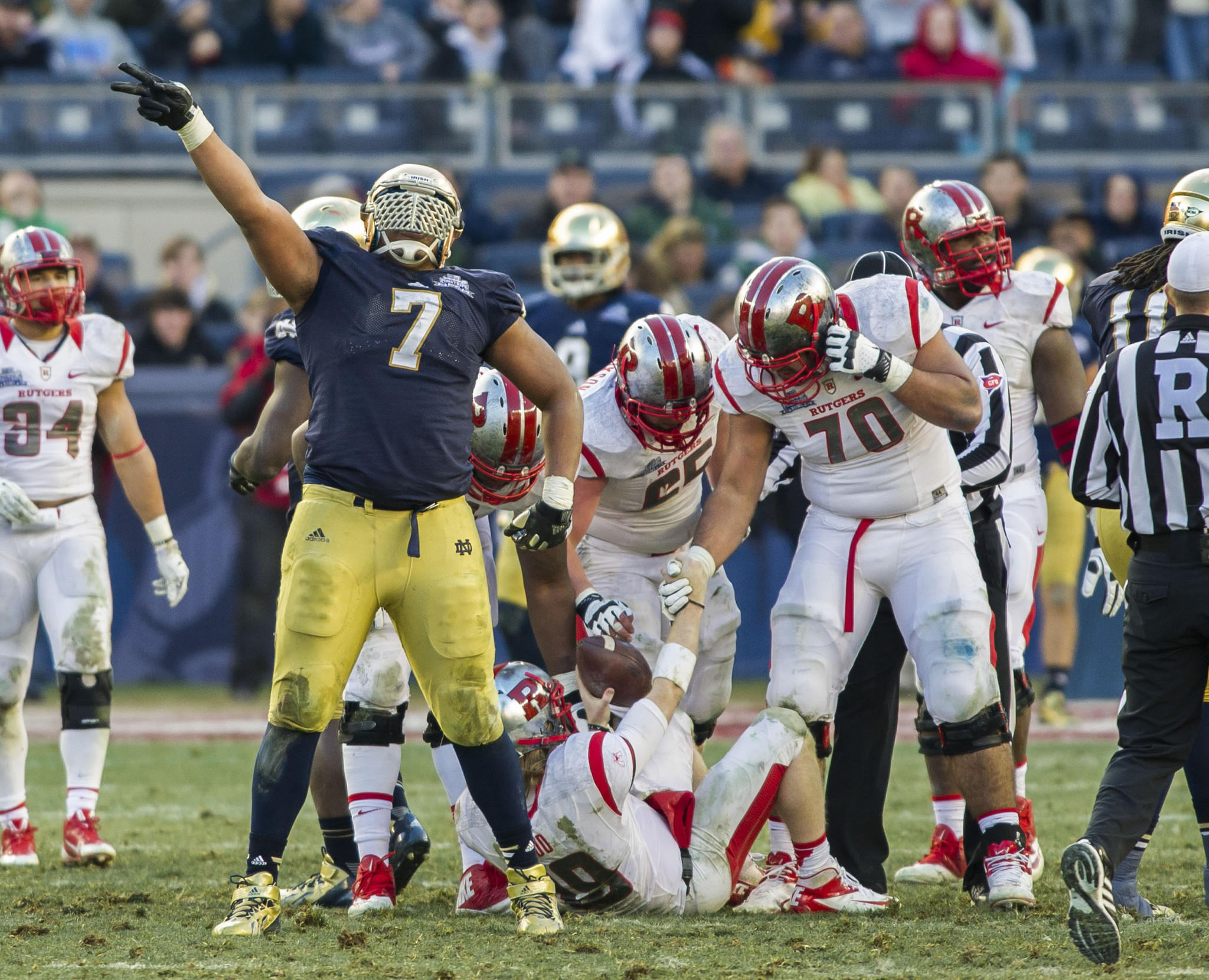 Notre Dame defensive end Stephon Tuitt celebrates after sacking Rutgers quarterback Chas Dodd in the fourth quarter of the Pinstripe Bowl at Yankee Stadium.