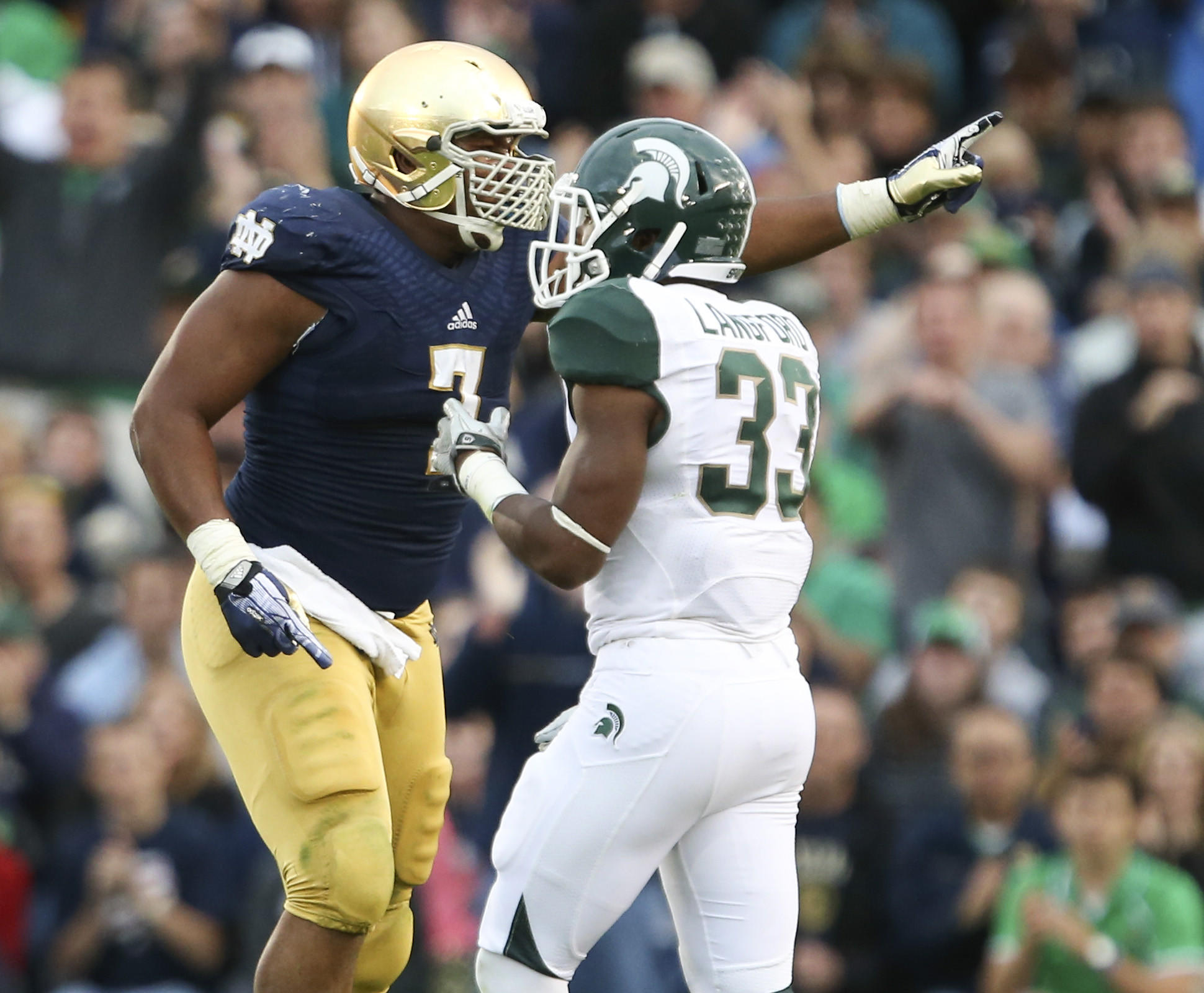 Notre Dame defensive lineman Stephon Tuitt points to his bench after a sack against Michigan State.