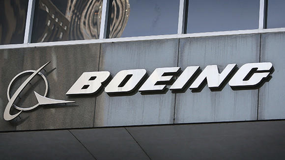 A sign hangs above the entrance to The Boeing Company's headquarters in Chicago.