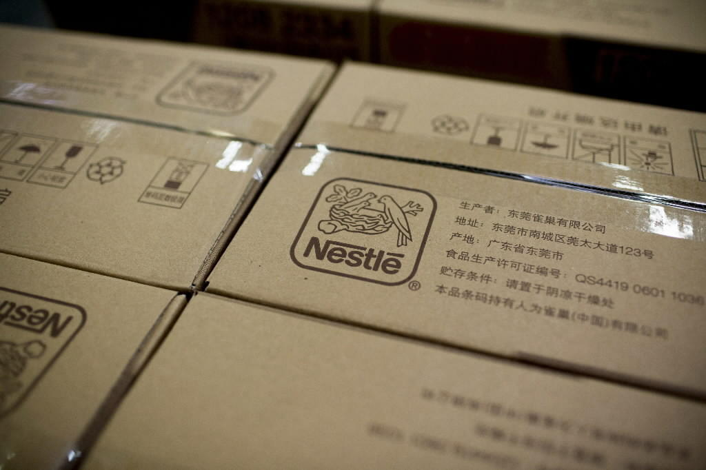 The logo of Nestle SA is displayed on boxes at a Nestle factory in China.
