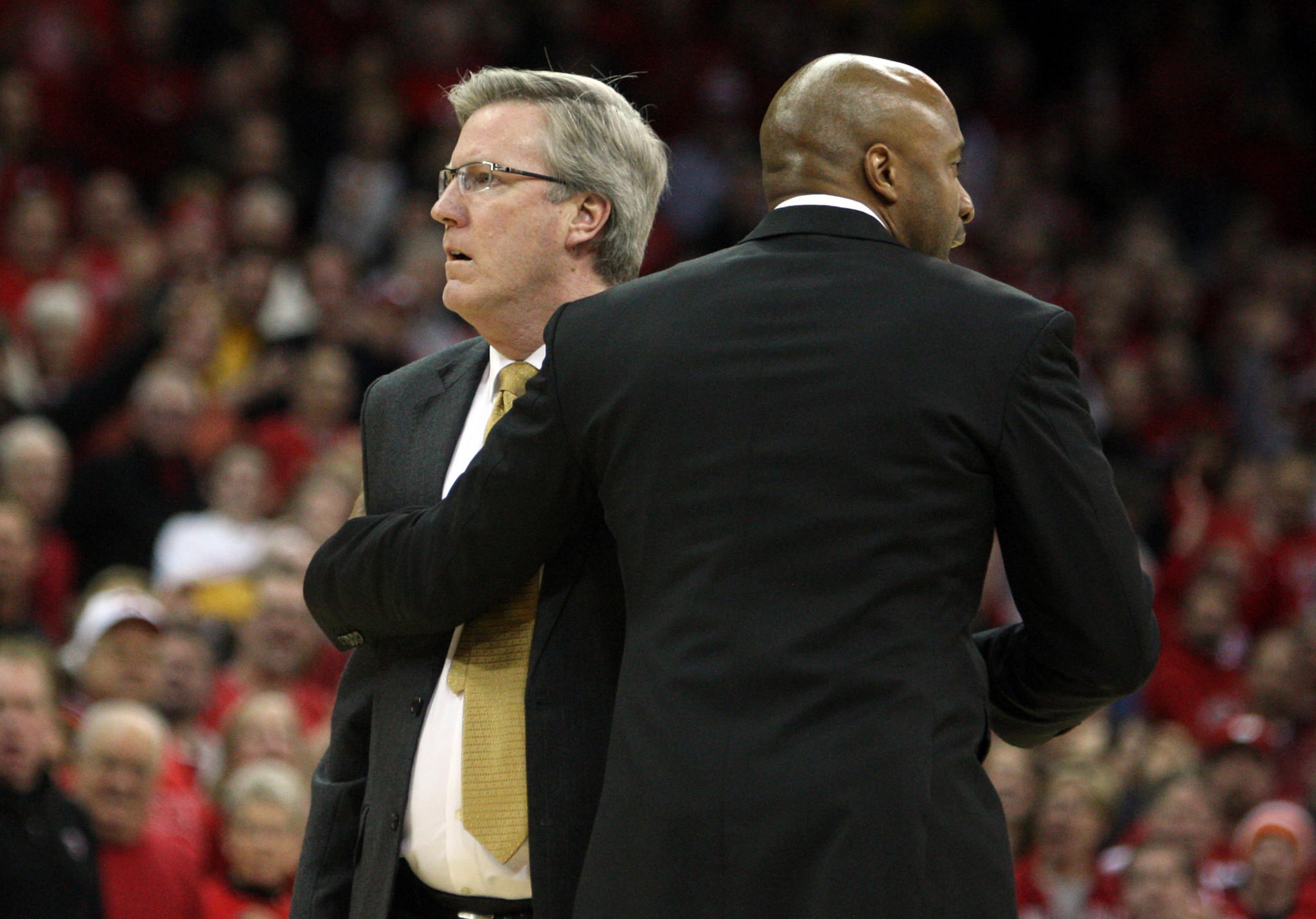 Iowa Hawkeyes head coach Fran McCaffery (left) is restrained by an assistant coach Andrew Francis after McCaffery was called for two technical fouls and then ejected from the game with the Wisconsin Badgers at the Kohl Center.