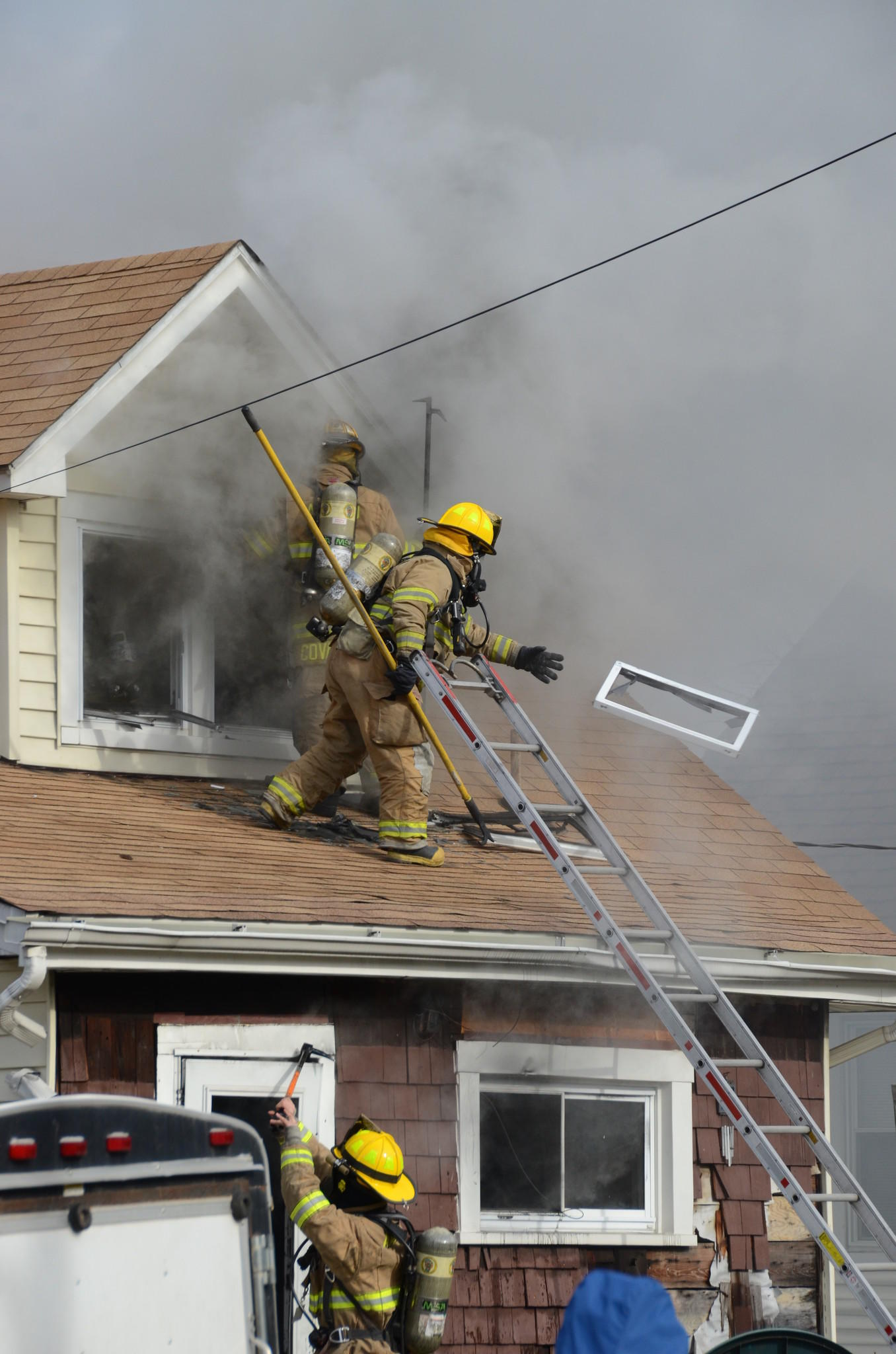 Anne Arundel County firefighters respond to a house fire at midday on Monday (Jan. 6, 2014) at the corner of 12th Avenue and Morgan Road in Brooklyn Park