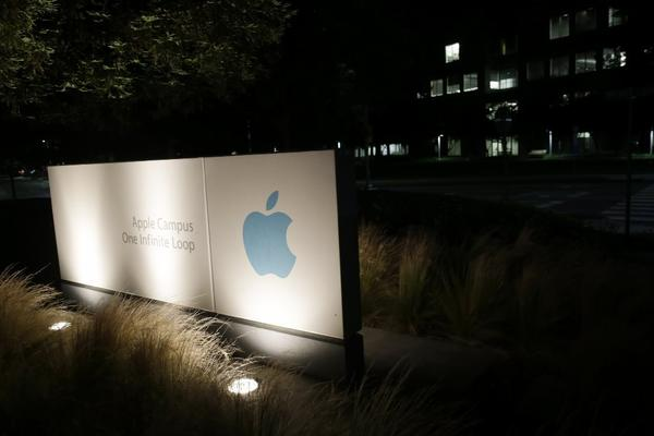 A sign displays the Apple logo in Cupertino, Calif.