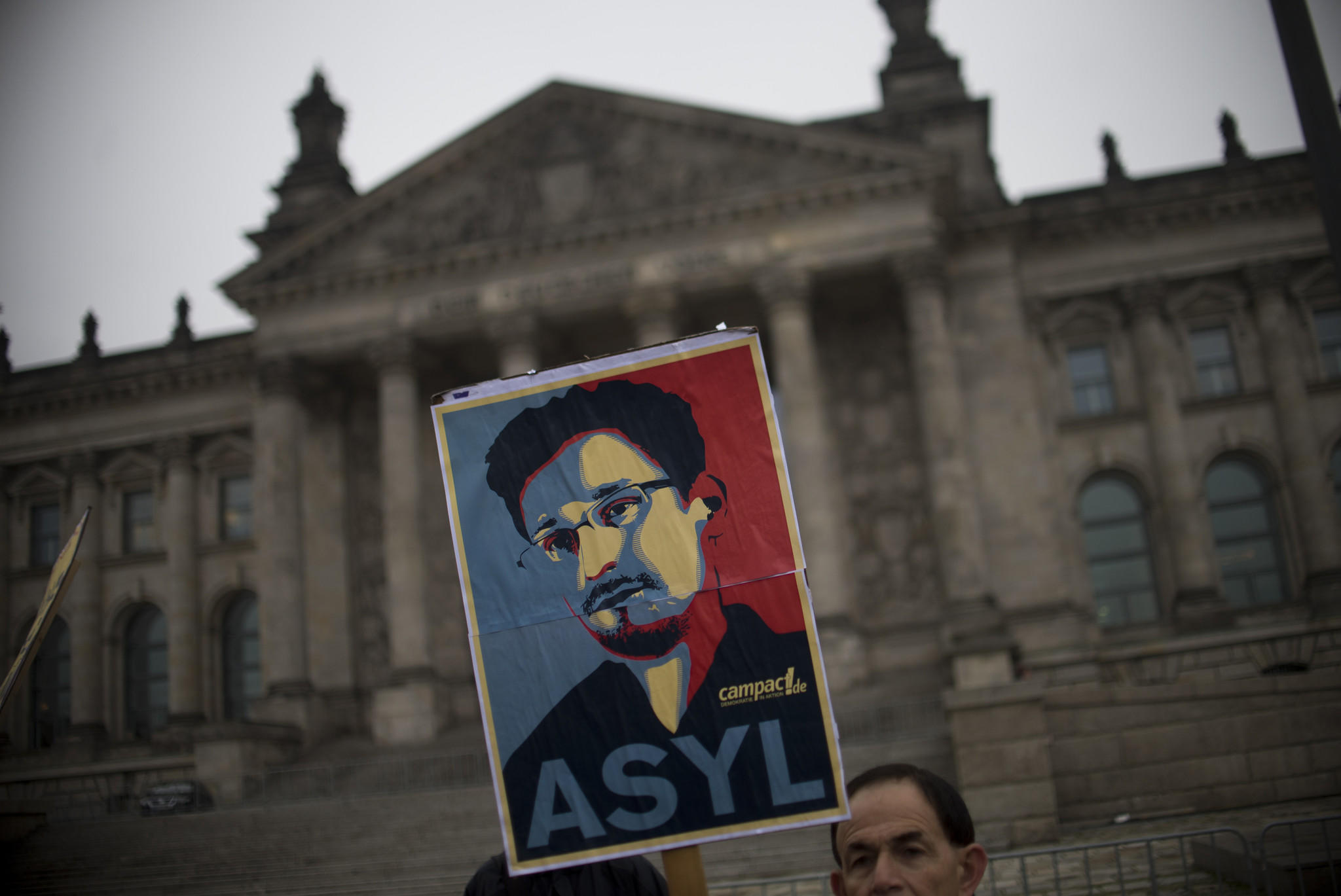 Activists hold up a portrait of in Berlin on Nov. 18, 2013.