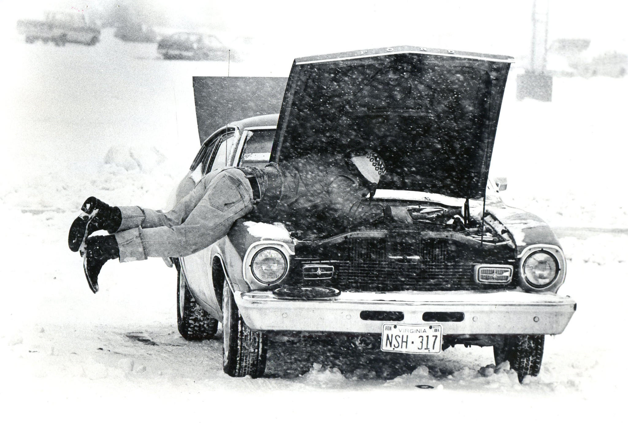 David Brown of Hampton replaces a carbureator in his Maverick which went out Sunday morning. March, 1980