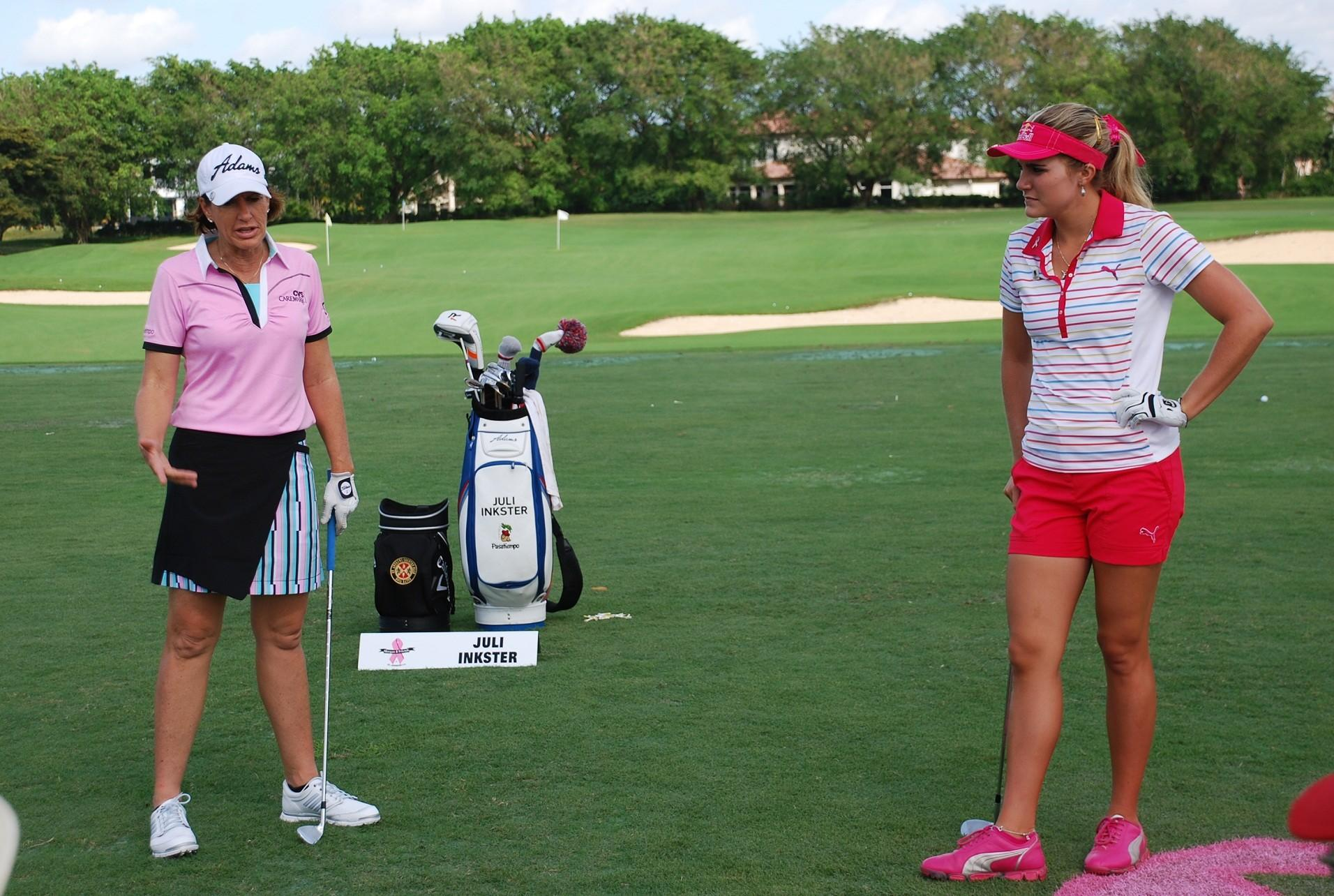 Juli Inkster, left, and Lexi Thompson talk about how they warm up before a round of golf during a clinic at the Morgan & Friends Tournament at St. Andrew's Country Club in Boca Raton.
