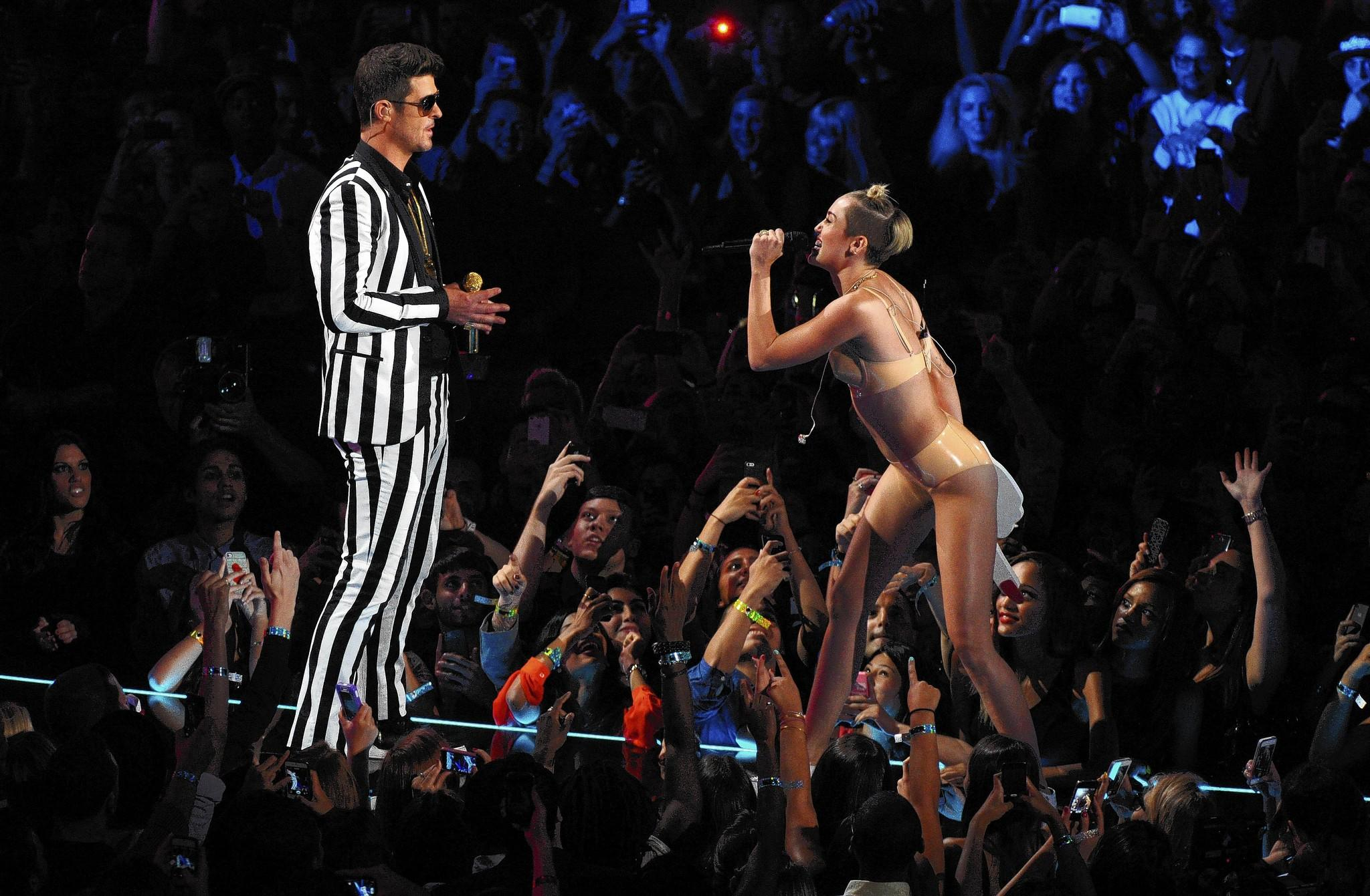 "Robin Thicke and Miley Cyrus perform ""Blurred Lines"" at the MTV Video Music Awards in August."