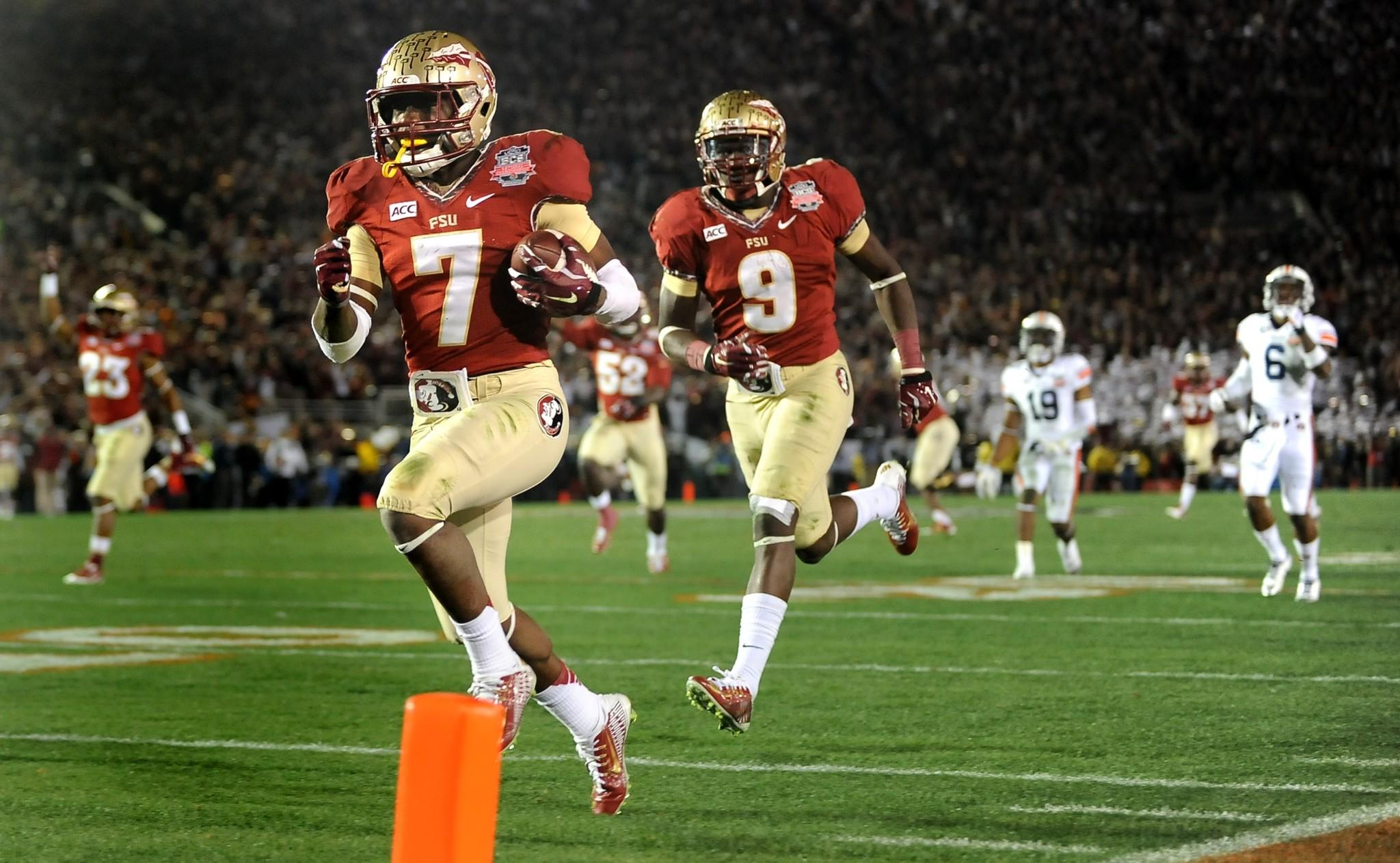 Florida State receiver Kermit Whitfield nears the goal line to complete a 100-yard kickoff return with 4:31 left in the fourth quarter to give the Seminoles a 27-24 lead in the BCS title game.