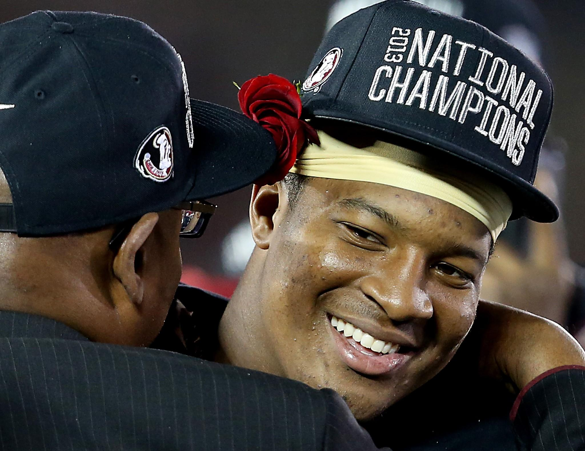 Florida State quarterback Jameis Winston is congratulated after leading the Seminoles to a last-minute victory over Auburn in the BCS national championship game on Monday night at the Rose Bowl in Pasadena.