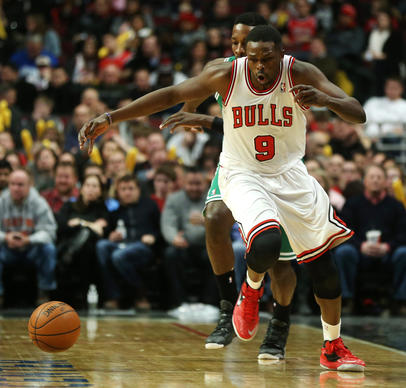 Luol Deng makes a steal during the second half against the Celtics.