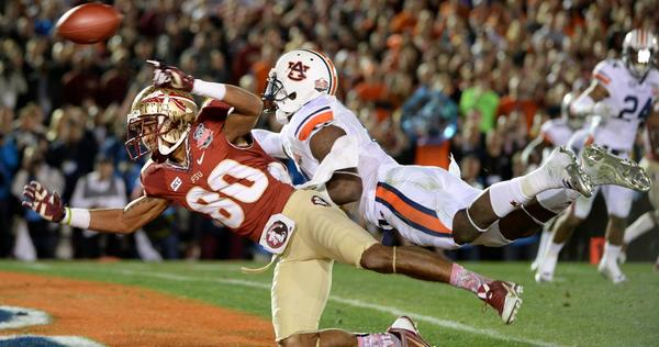 Auburn cornerback Chris Davis makes contact with Florida State receiver Rashad Greene in the end zone on a third-and-goal play in the final minute of the BCS title game, drawing an interference penalty.