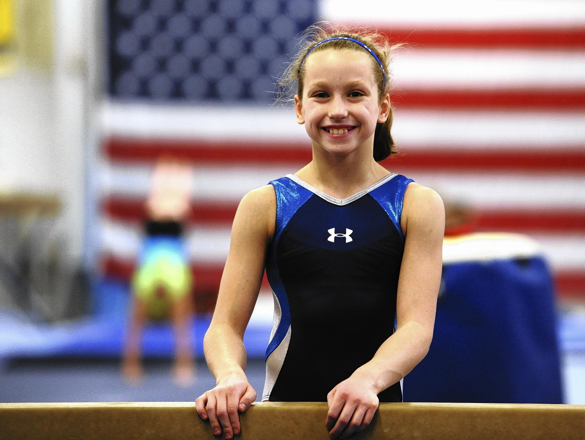 Alexa Brinker pauses during a workout at the Parkettes National Gymnastics Training Center in Allentown.