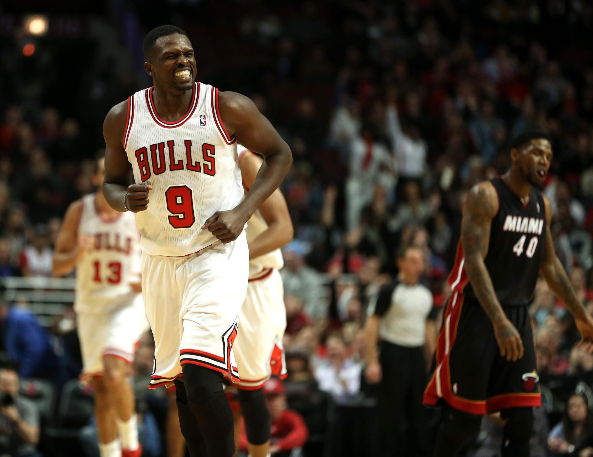 Chicago Bulls small forward Luol Deng smiles broadly as he runs up the court after burying a jumper late in the fourth quarter against the Miami Heat at the United Center.