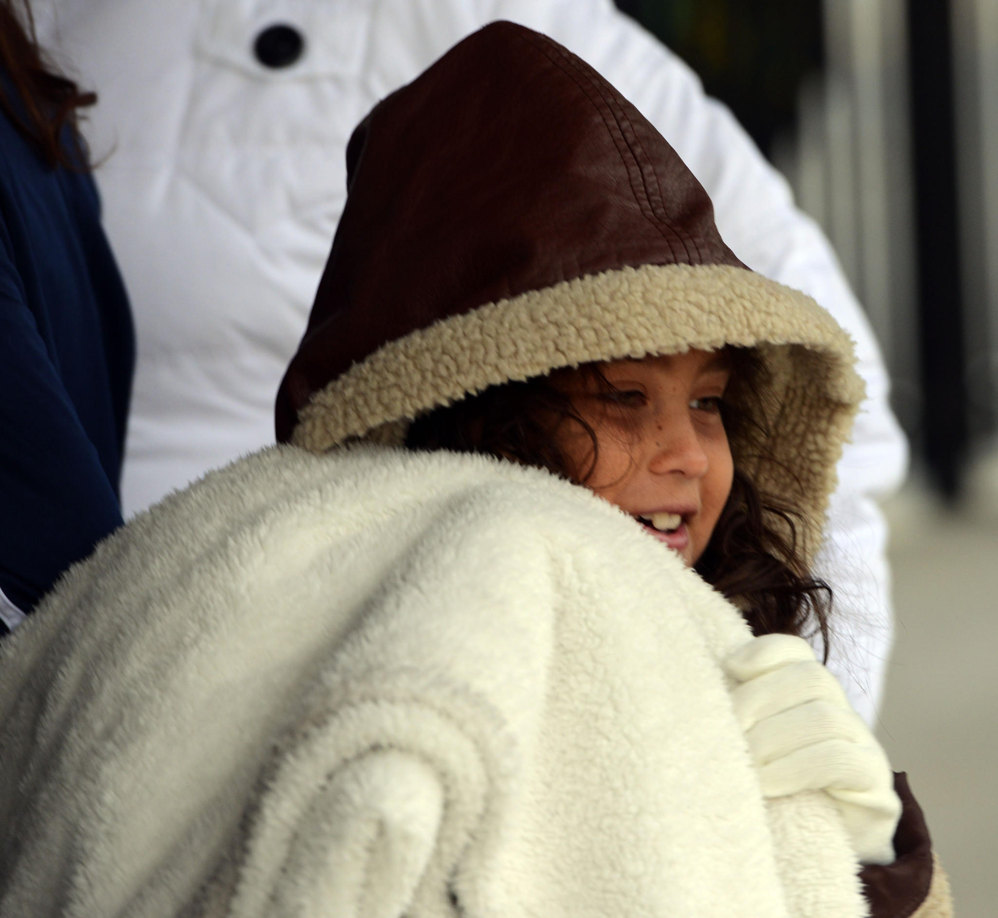 Catalina Perea, 9, bundled up in a coat and a blanket while waiting for an Amtrak train with her family at the West Palm Beach station Tuesday morning when the temperature was around 50 degrees.